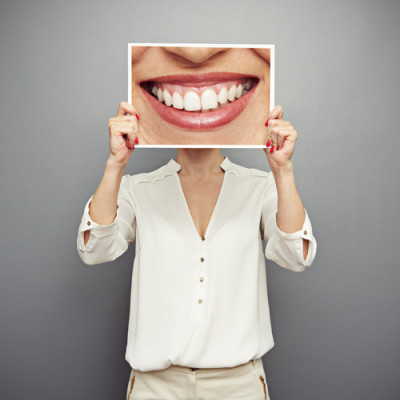 woman holding smile picture - Preventing Cavities in Port Orange