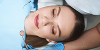 Sedation Dentistry Port Orange FL Woman Relaxed in the dentist chair